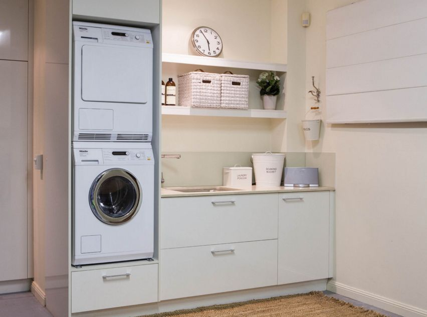 Small Laundry Room With Stackable Washer And Dryer And Sink