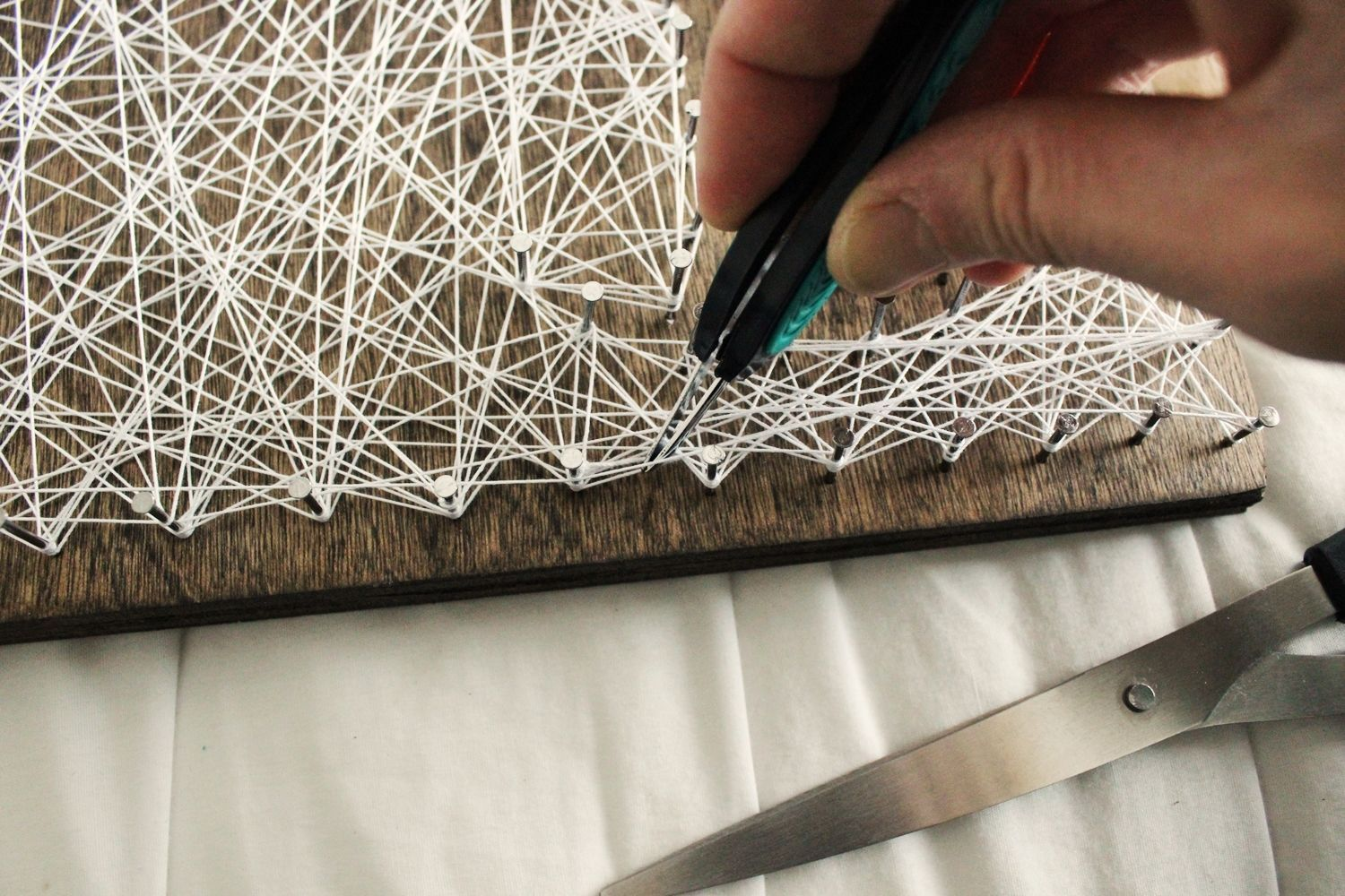 DIY String Art Tree - Trim the string very close