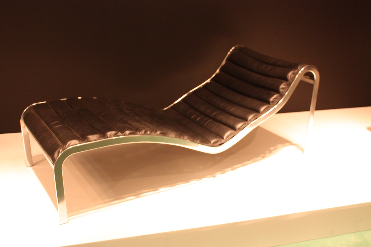 The Whist Chaise Longue, designed in 1964 by Olivier Mourgue is made of steel and black leather.