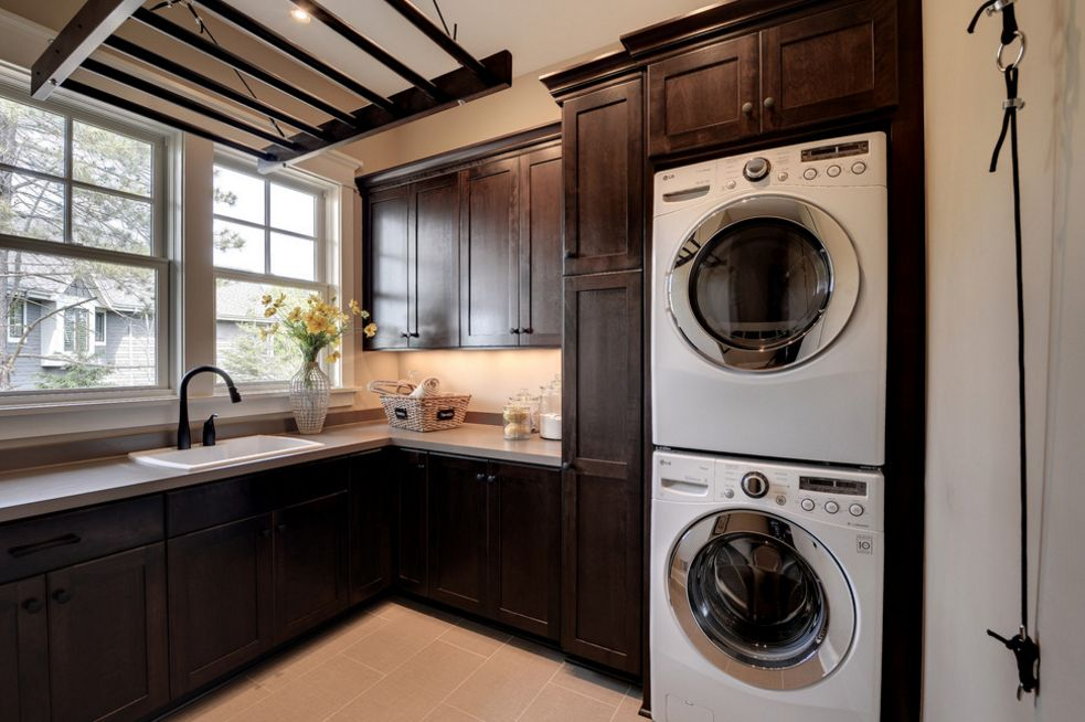 Dark stained wood laundry room
