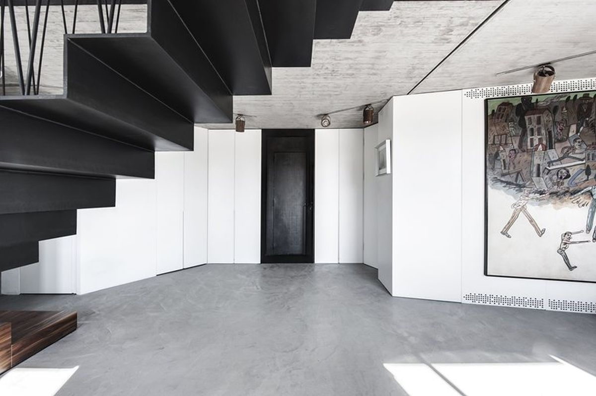 Duplex penthouse renovation lower level austere decor