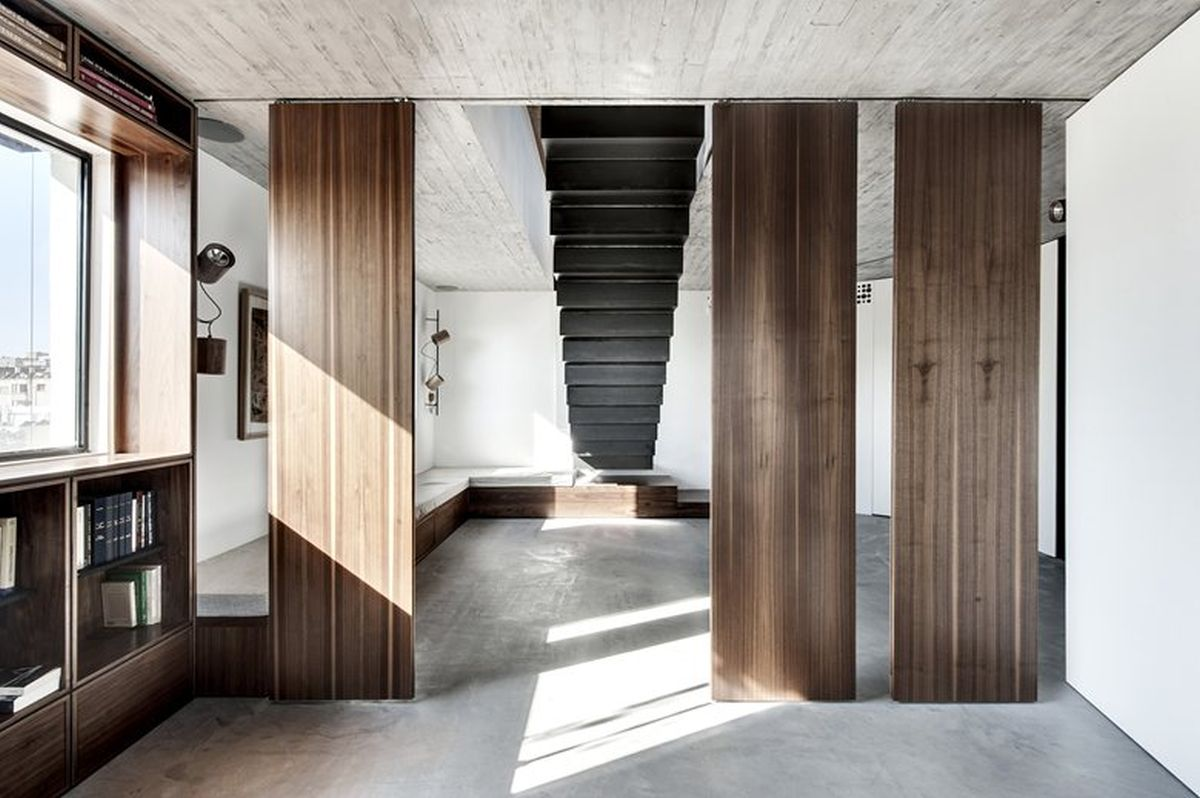 Duplex penthouse renovation lower levels wood panel dividers