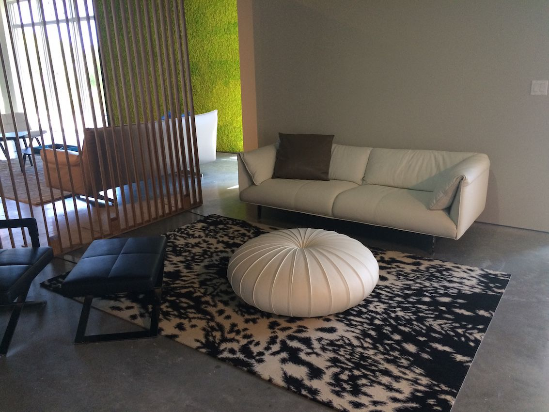 This sofa, ottoman and patterned rug are best for casual spaces.