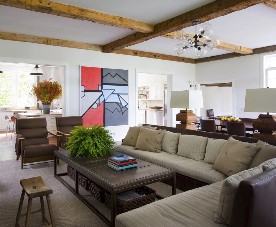 Farmhouse Fmaily Room With Exposed Ceiling Beams and Touch of Greens