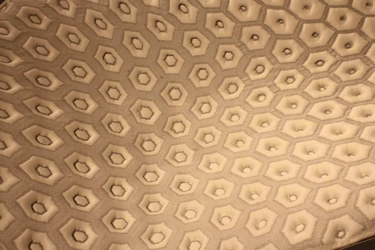 A close-up of the stunning fabric. It is copper and nickel plated 3D printed polyamide, silk, cotton and Merino wool.