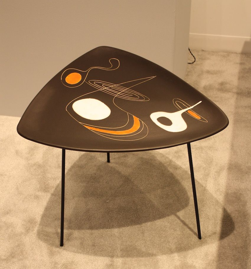 The Thomas Fritsch Gallery has a collection of interesting tables, such as this one. Designed by artist Roger Capron in 1955, it is a gorgeous modern piece.