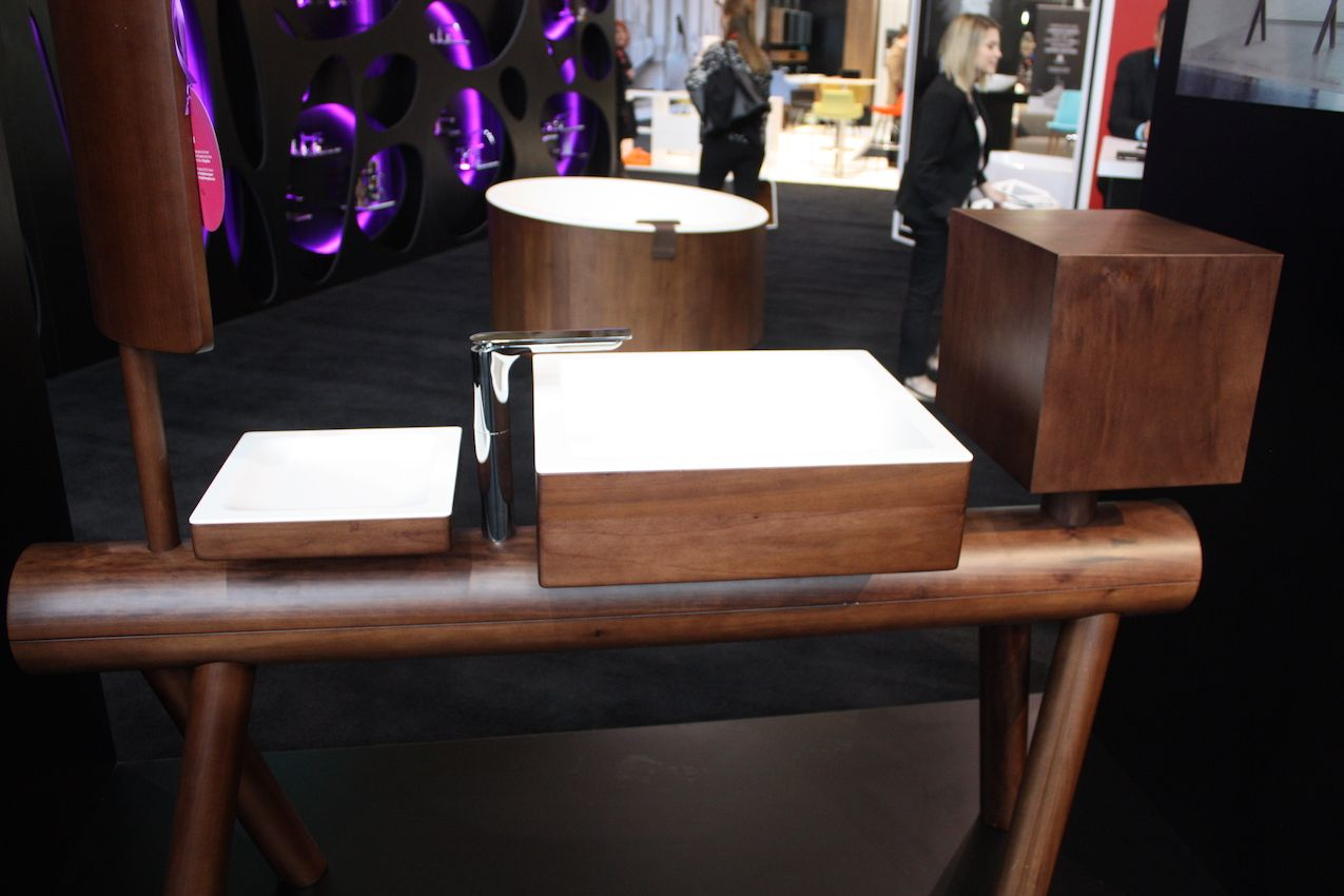 "From Graff, the newest collection, called Dressage, ""is furniture with a strong handicraft and manufacturing element, where the warmth of tradition, transmitted by the use of solid wood, meets with the functionality of an innovative material,"" says the promotional material. It calls the collection ""designed for the bathroom but inspired by the world of interior design."" The mirror at the left end swivels for convenience."