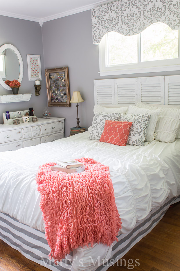 Gray And Coral Bedroom Featuring White Fluf Bedding