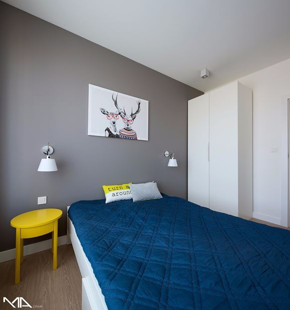 Grey bedroom design with yellow touch