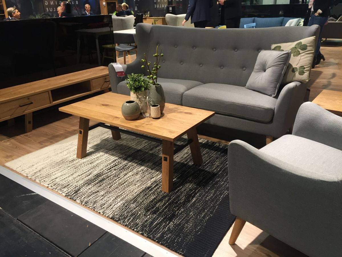 Grey sofa and armchair with a wood tall coffee table