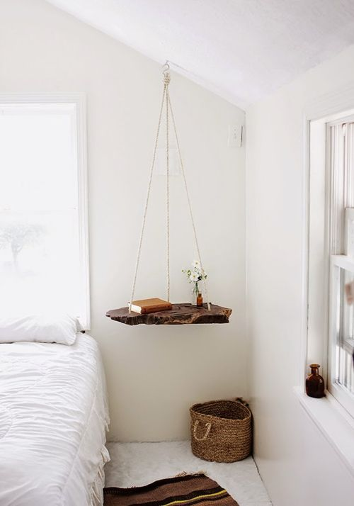 Hanging wood shelf used like nightstand