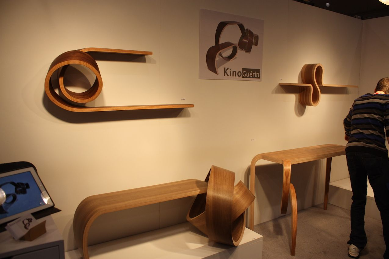 "Kino Guerin is known as a master of bending wood. The artist's spent 12 years researching and experimenting with vacuum press lamination. His work ""has allowed him to push the limits of the process in a uniquely fluid way. With each furniture design, Kino Guerin creates an airiness and lightness, a piece of functional sculpture,"" writes Artful Home."