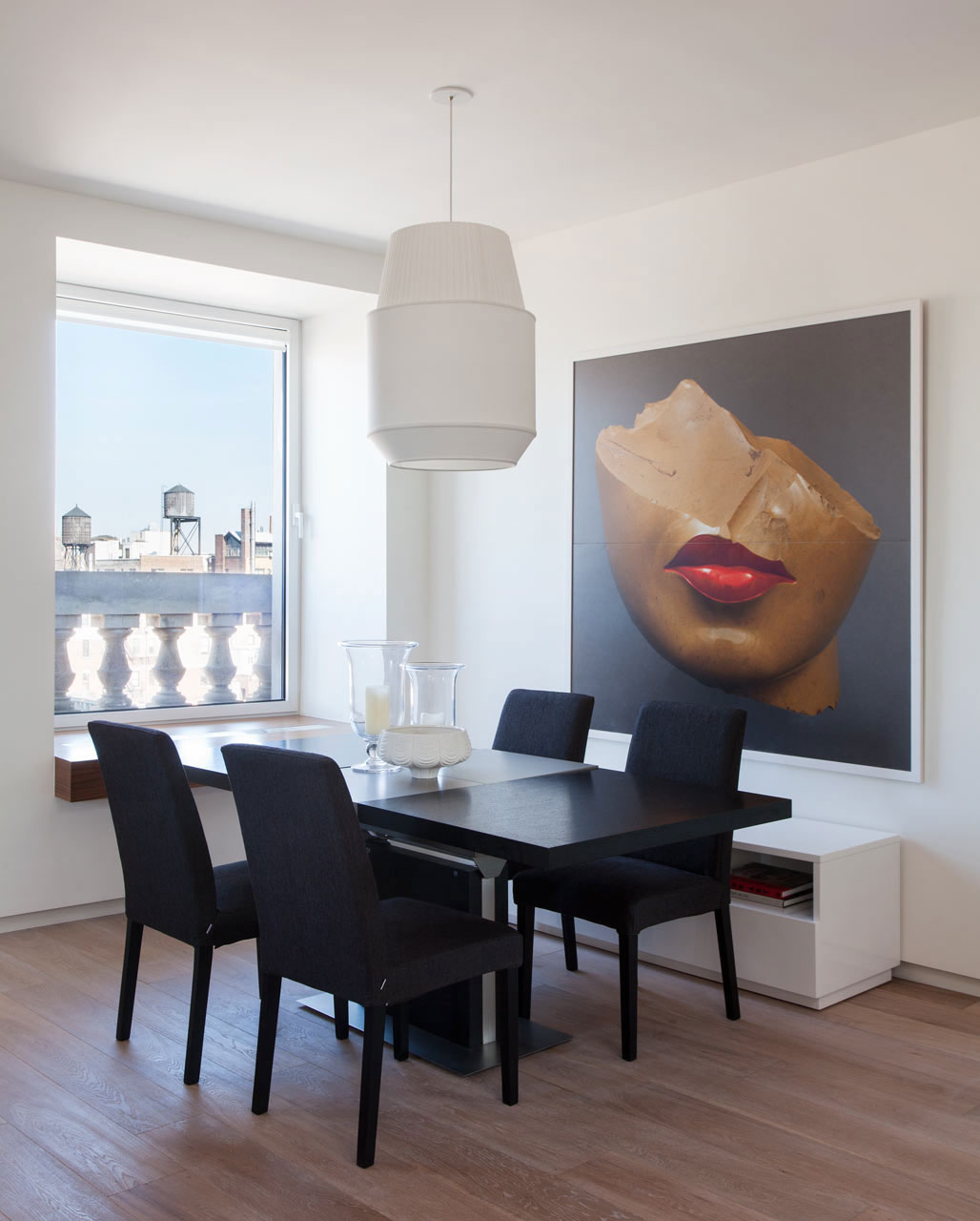 Large dining room with a beauitful portrait wall art How To Add The Wow Factor Through Modern Wall Art