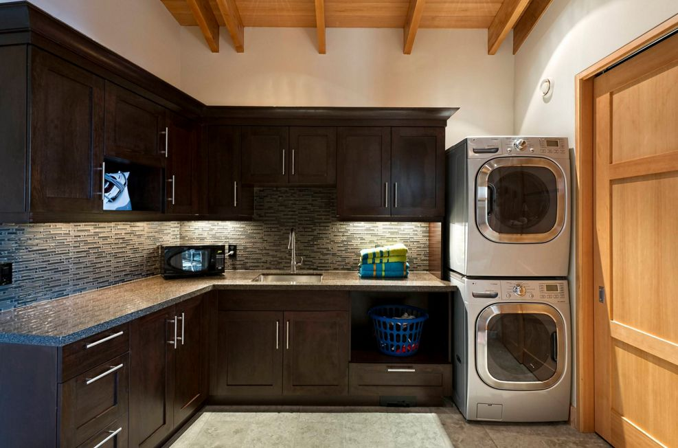 Laundry room featuring stacked washers and dryers