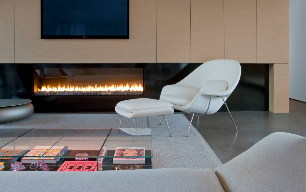 The elegant design of the chair makes it work in any space.  Here, it is a perfect addition to the living room, but is still cozy enough to be an inviting fireside seat.