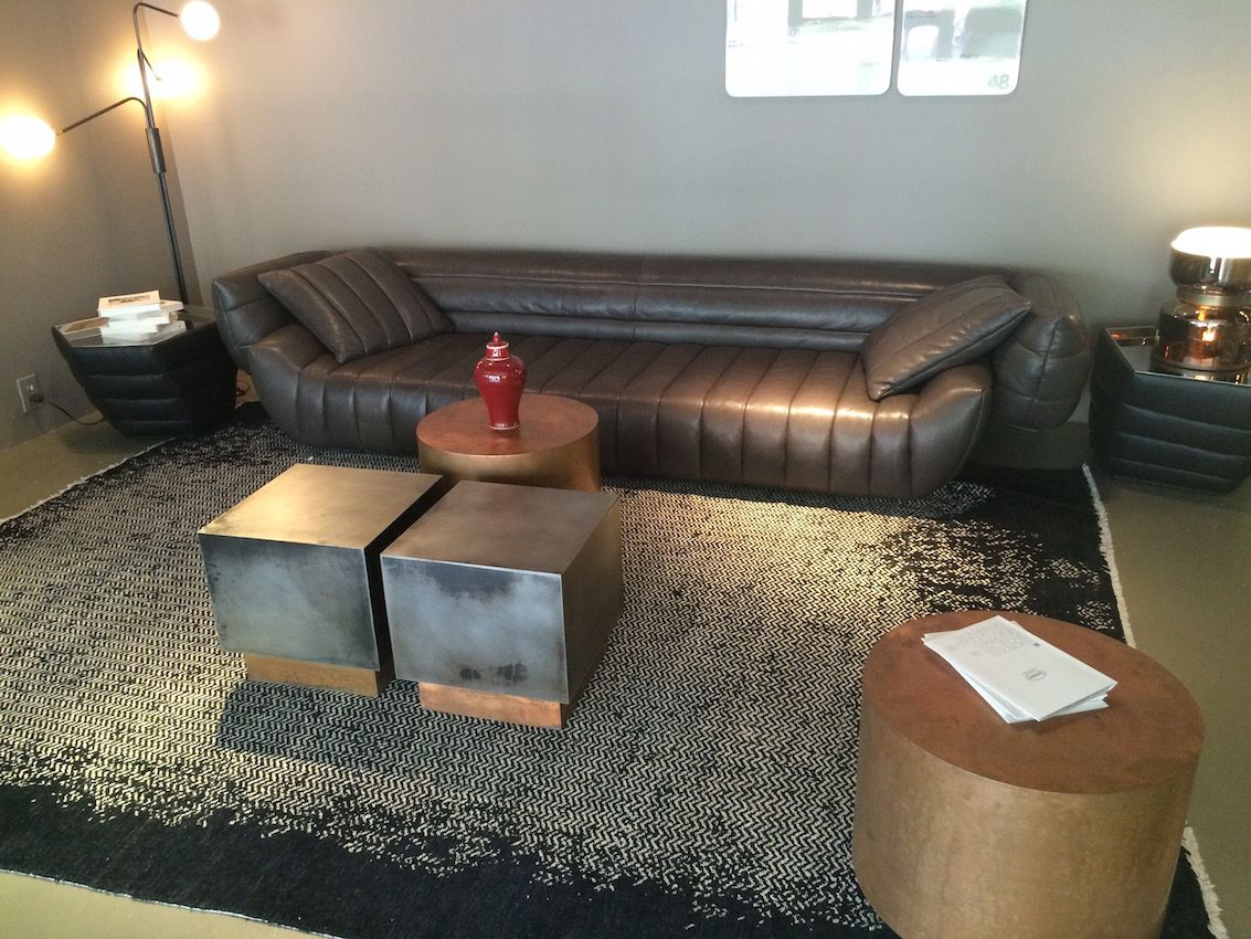 This cool collection could really go either way -- it could easily be a masculine formal living room. The leather sofa is durable enough for everyday use, so perhaps with a different cocktail table, it would work well for a family room.