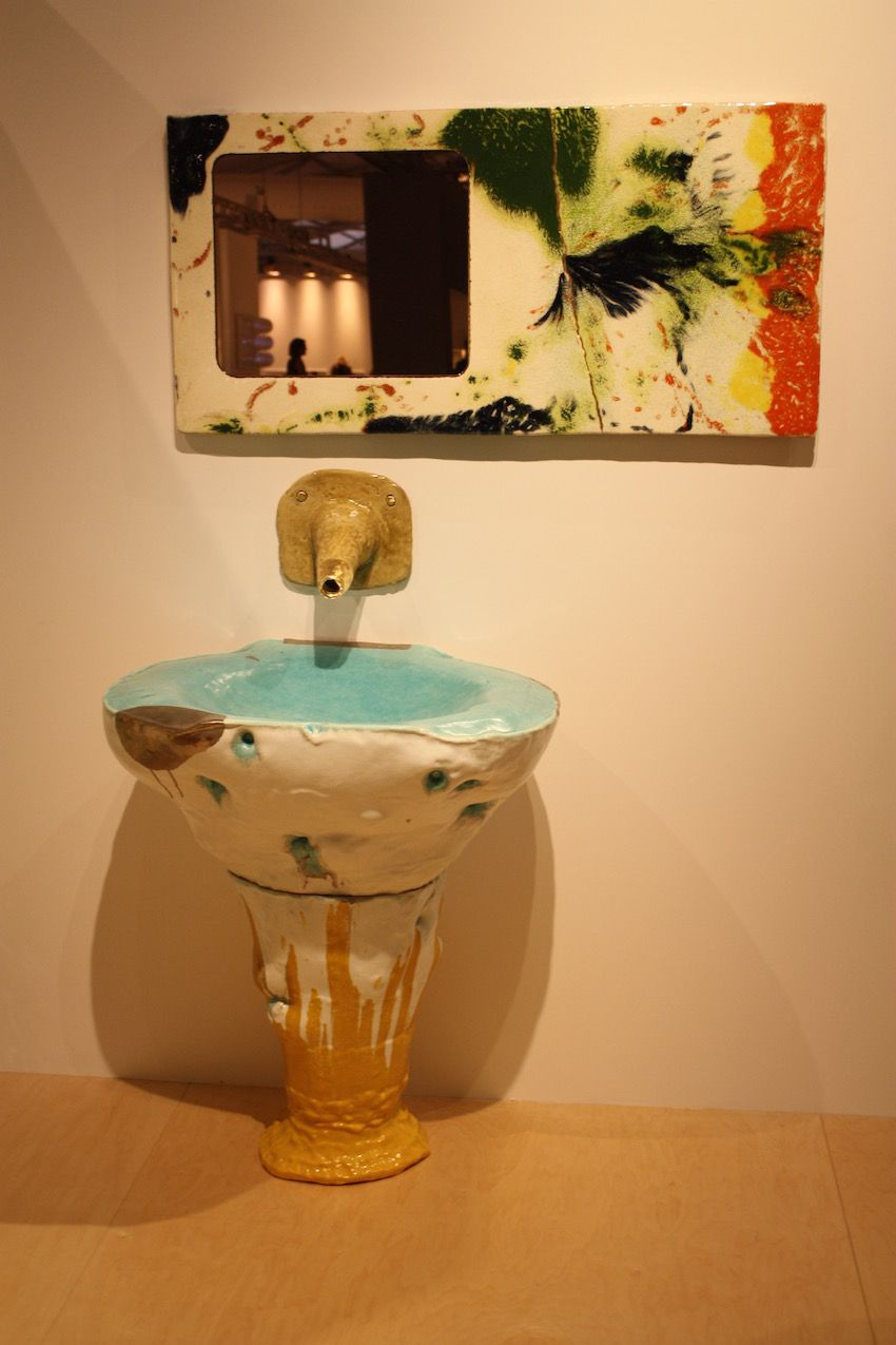 The glazes the artist uses are unpredictable, resulting in different color expressions, which only add to the unusual nature of the sink and mirror.