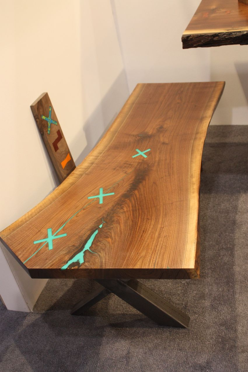 "MetalWood Studio showed live edge benches with a twist: The resin used in the gaps is done in a bright aqua for added interest. According to the Artist: ""Why not? I love color!"""