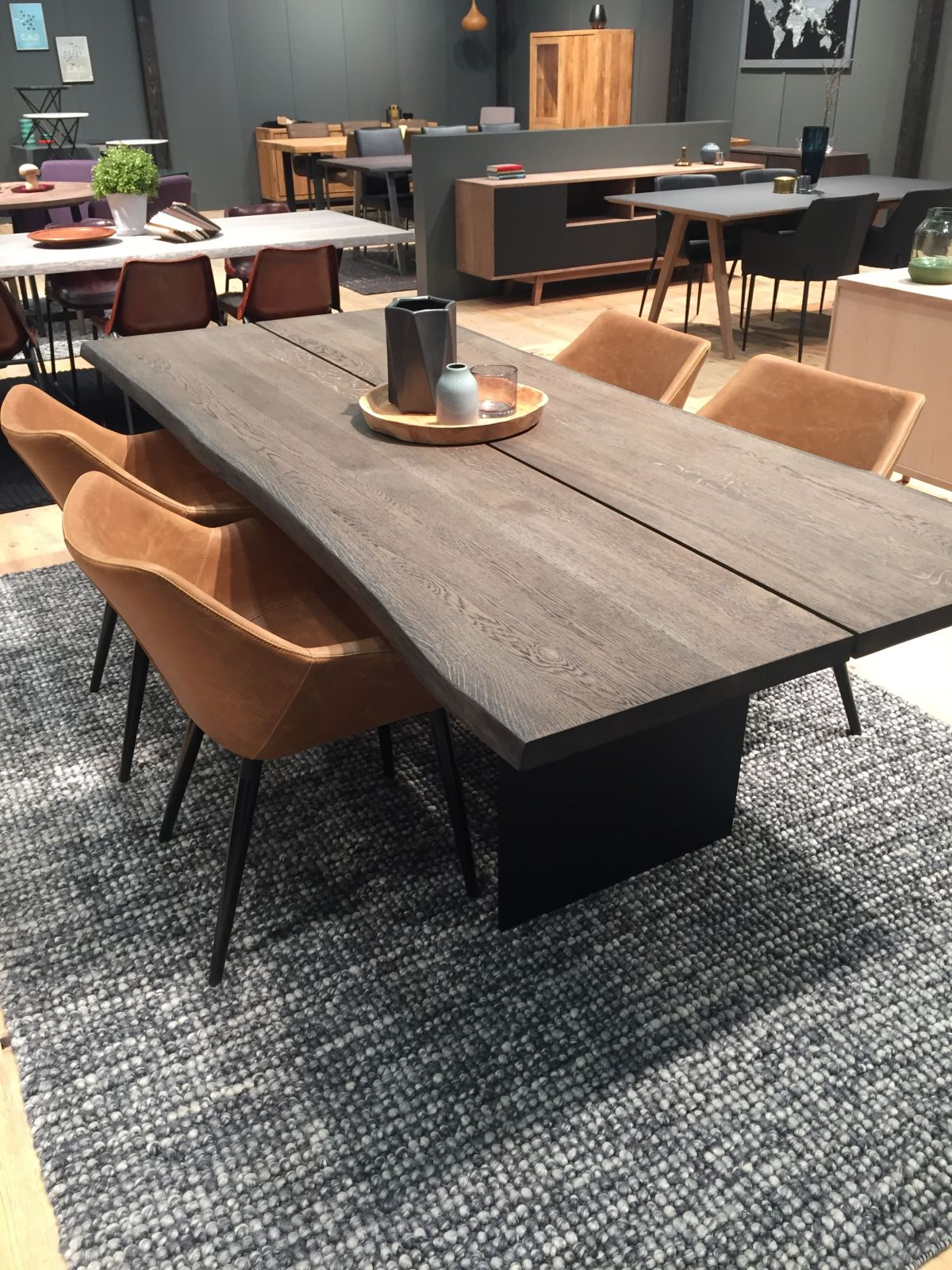 Modern Cutting Edge Wooden Table With Brown Leather Chairs