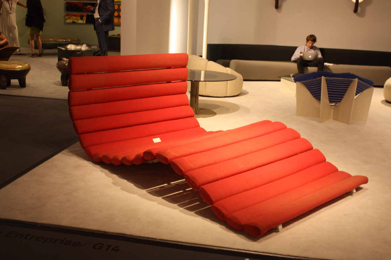 "The prolific Paulin design this extra large modern lounge, ""Decline,"" in 1968. IT is made of wood, aluminium, and foam textile. There are only wo known pieces like this and one is in the Pompidou Center in Paris."