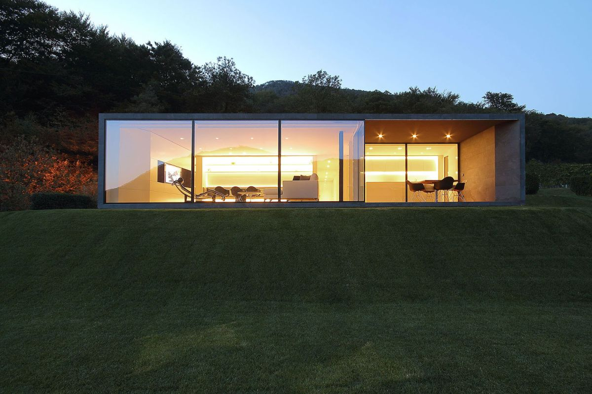 Montebar Villa in Swiss Alps glass facade at night
