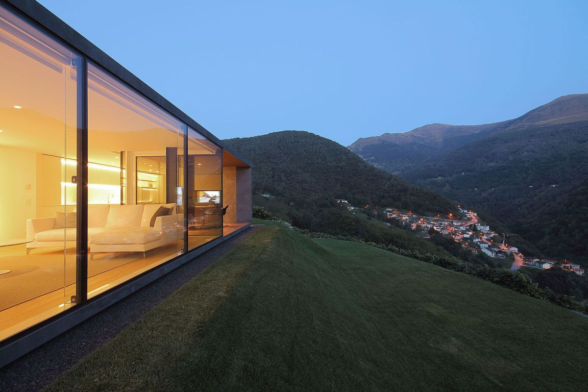 Montebar Villa in Swiss Alps glass walls and valley view