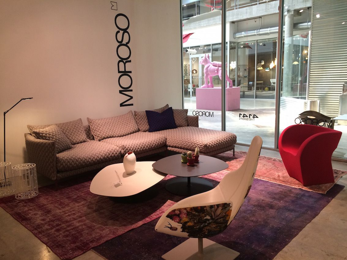 While the eclectic chairs in this grouping from Moroso mightbe great in a formal space, the texture and the coziness of the sectional sofa make this a perfect setting for a living room. All the pieces can be found at 4141 Design in Miami.