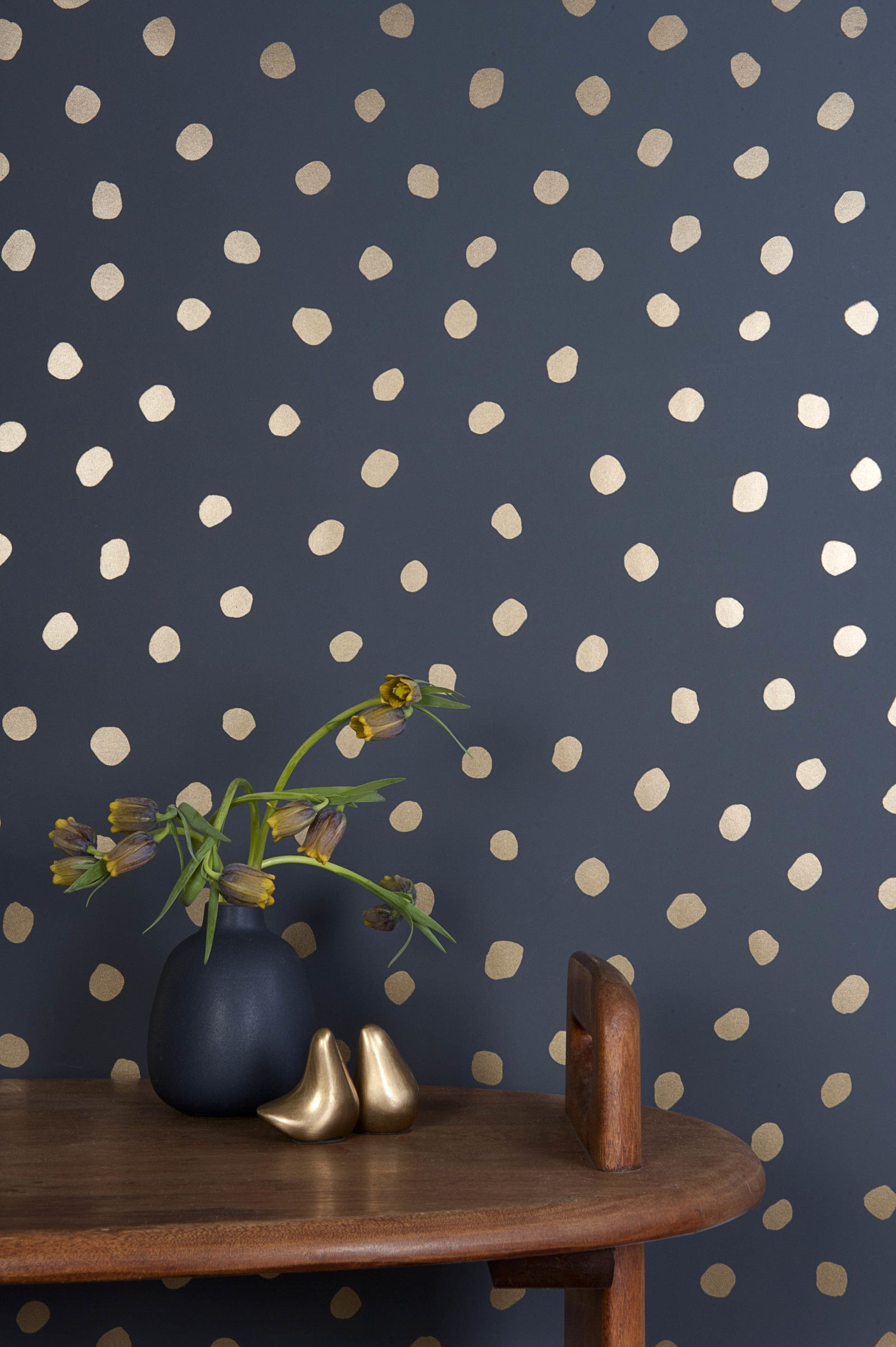 Navy blue and gold polk dots
