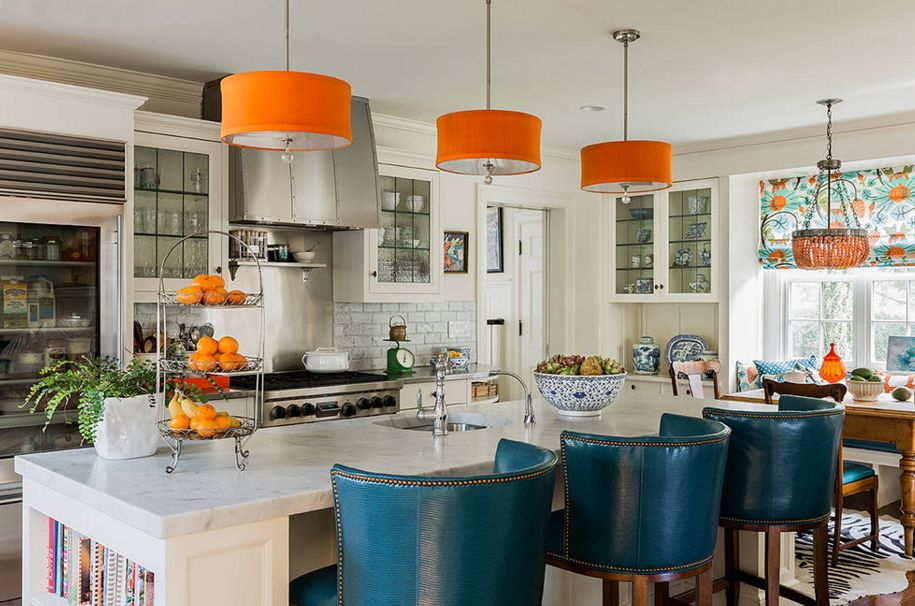 Orange pendant lamps over the kitchen island
