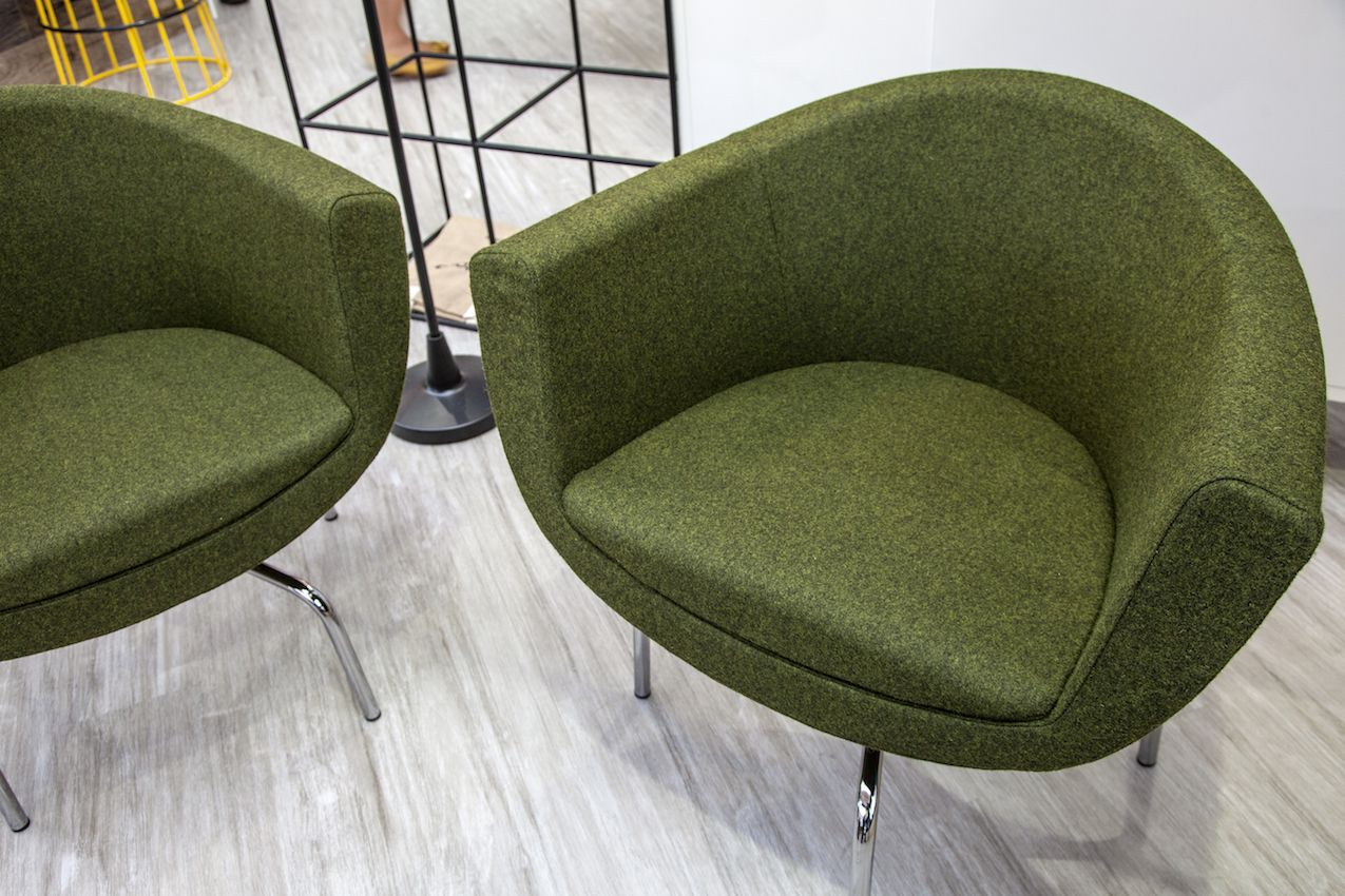 A matched pair like this could be substituted for a larger, heavier love seat in order to lighten the space.