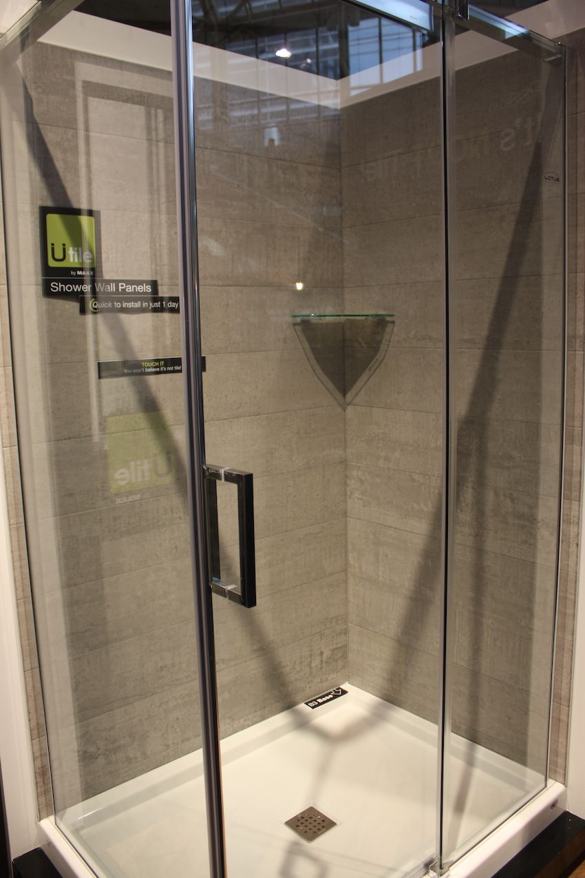 This may look like your average tiled shower, but it's actually paneled with a new product from Utile. The panels look and feel just like real tile, but they have no real grout, making cleaning easy and durability outstanding. They are installed in the shower over the wall. For renovations, the original tile must be removed. Utile comes in a variety of patterns and colors.