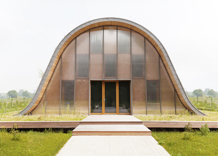 Patrick Nadeau Green-Roofed Wave Home Facade