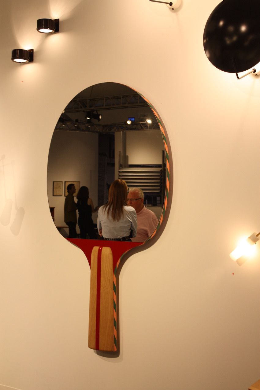Ping pong anyone? We can;t think of a more perfect mirror for a fun family room area than this one from Gallery Kreo.