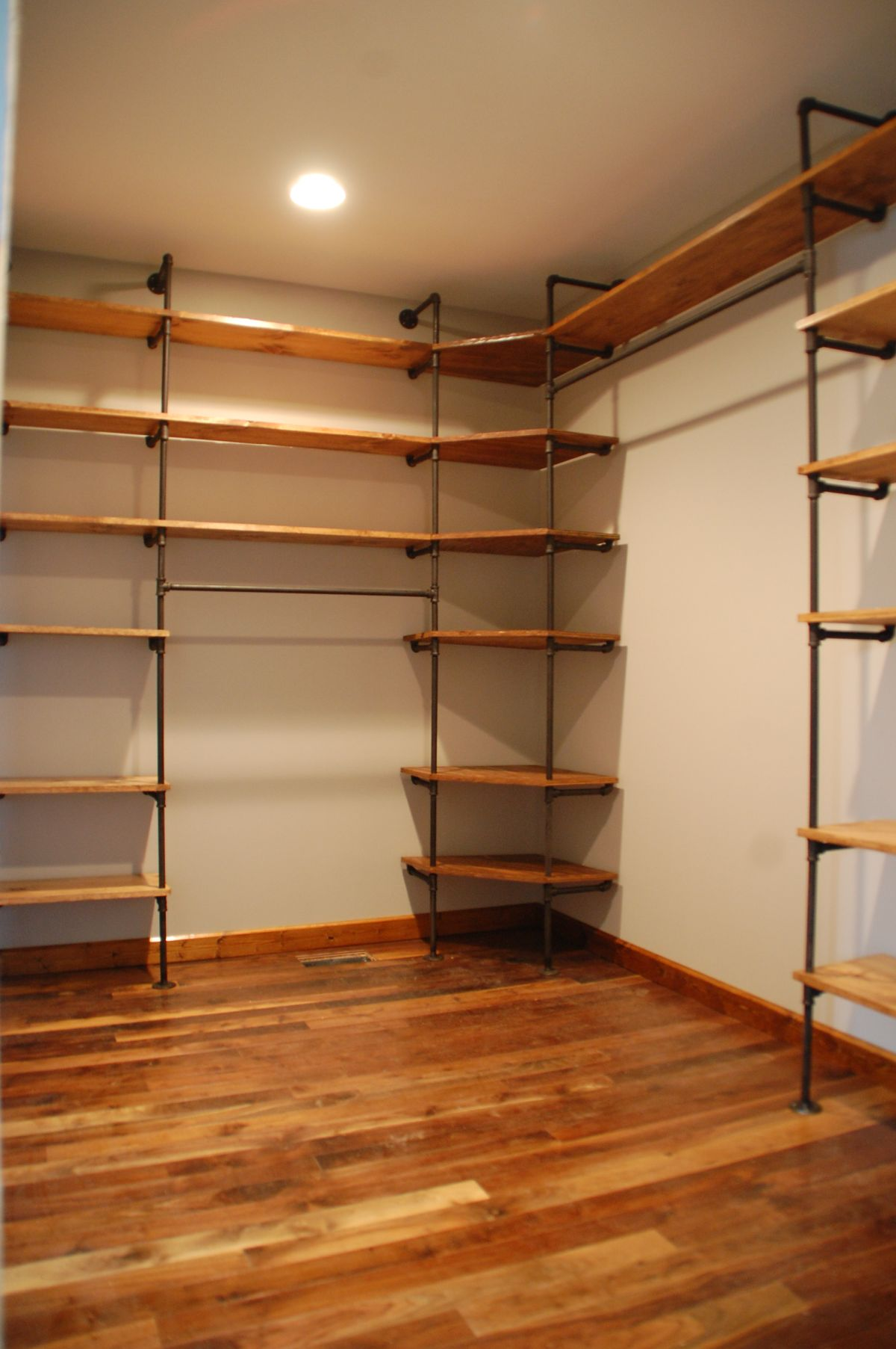 Pipes And Wood Closet Shelves