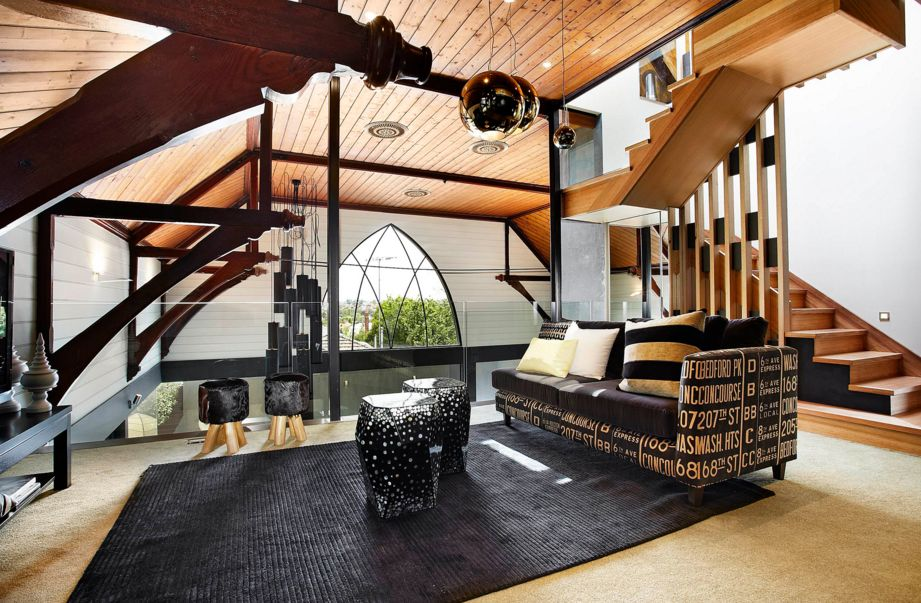 The shape of a black rug can also influence a room's look