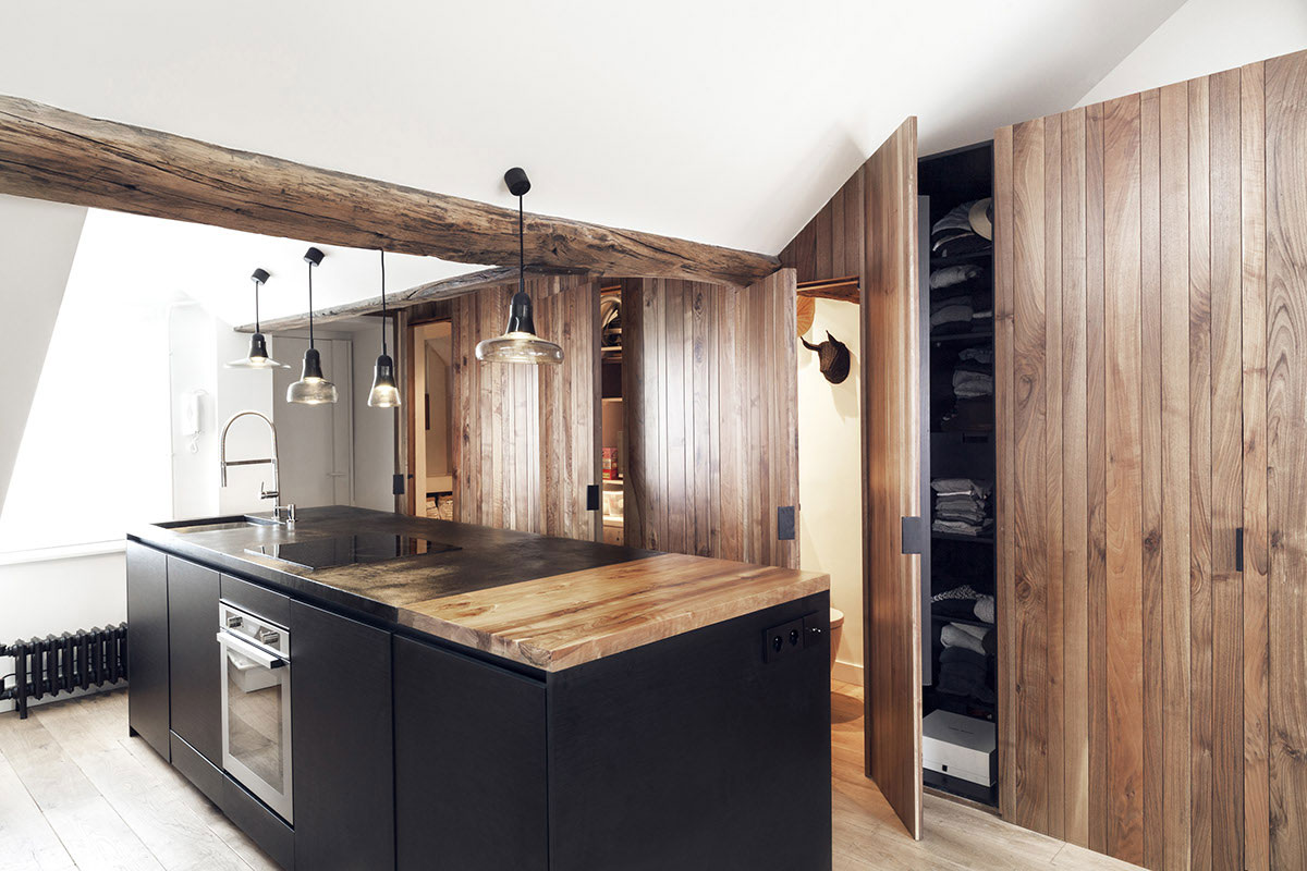 Remodeled attic apartment in Paris black kitchen island