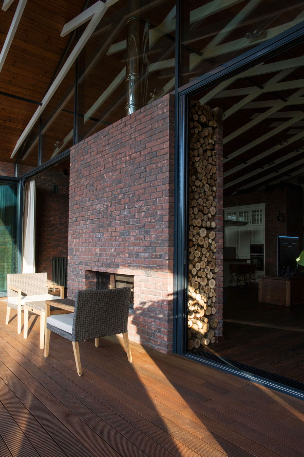 Rostov house by Chado fireplace and firewood storage