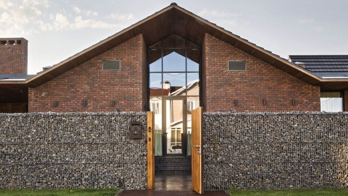 Rostov house by Chado gabion walls and entrance
