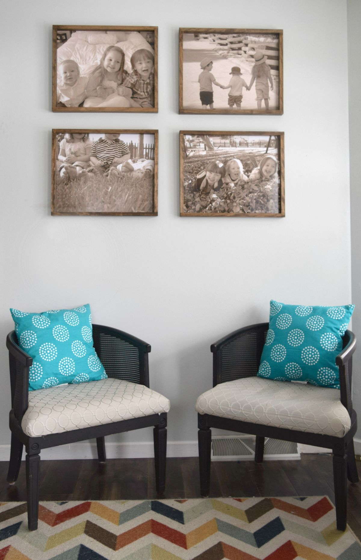 Seating area with four rustic frames above