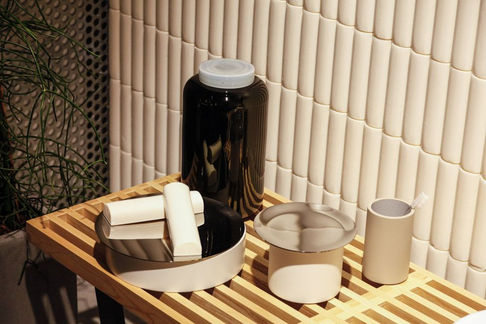 Detail of the soap wall and Vitra bench