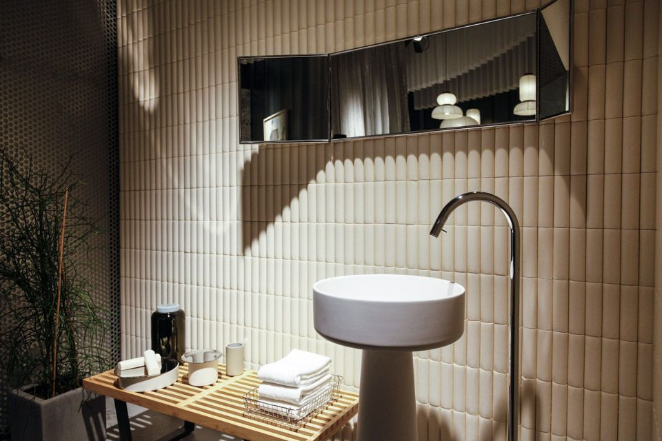 The stylish bathroom has a pleasant soapy scent from a soap 'brick' wall