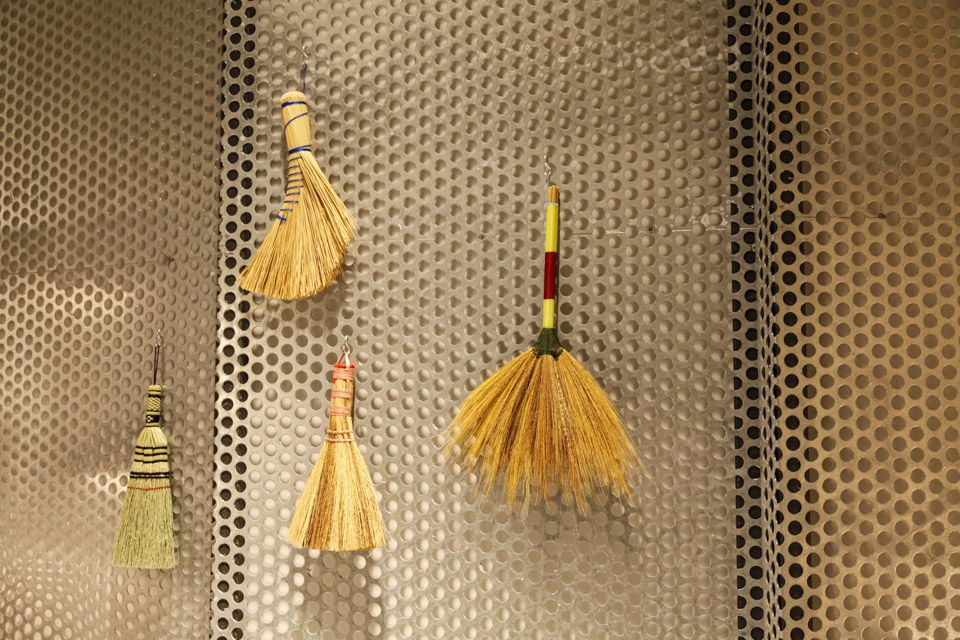 Natural brush bathing accessories hanging on the metal wall