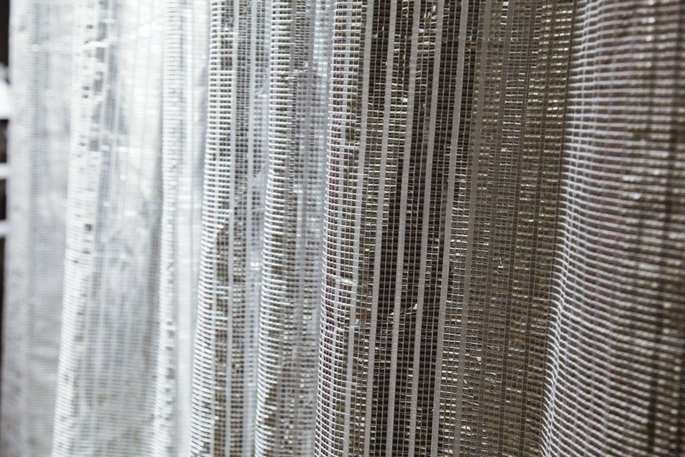 Metallic Curtain divider encircles the bedroom