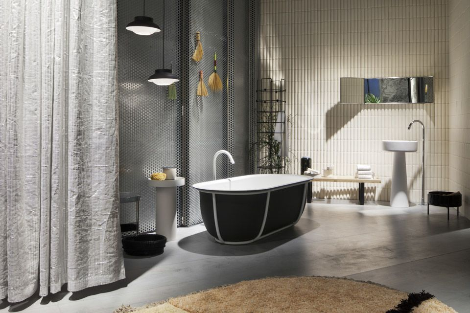 The open plan bathroom design connects to the bedroom