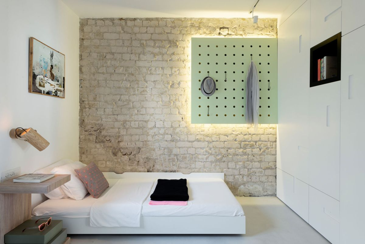Small apartment remodel in Tel Aviv second bedroom brick wall