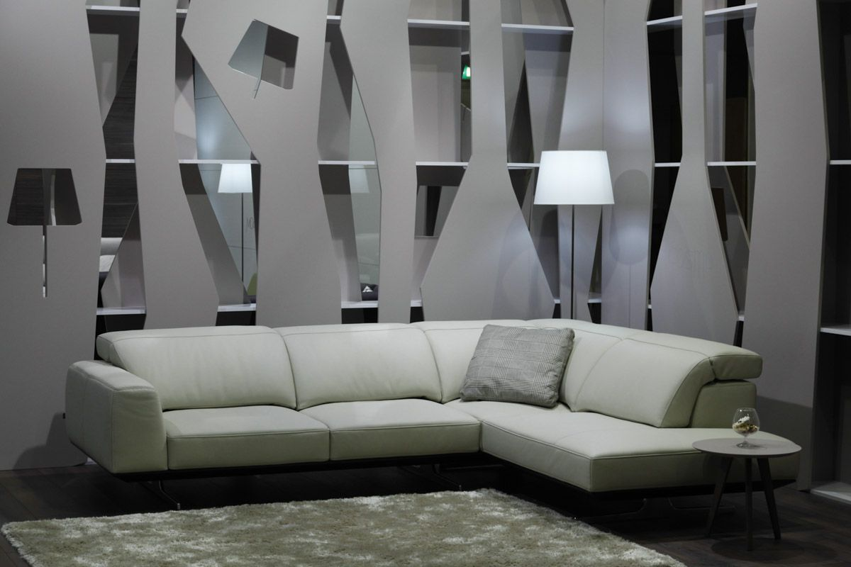 L shaped Solo lift white leather sofa