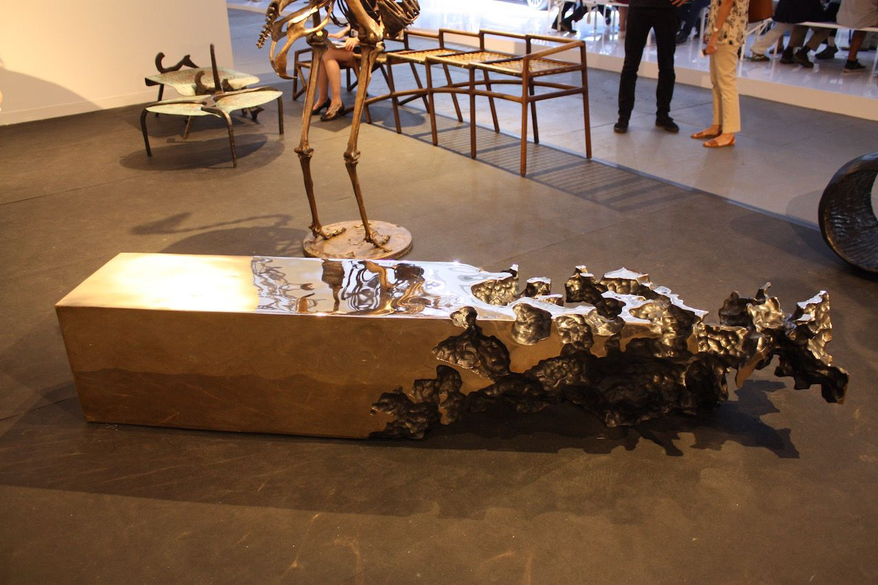 Also from the Southern Guild in Africa, this unique cast metal table is a conversation piece for sure.