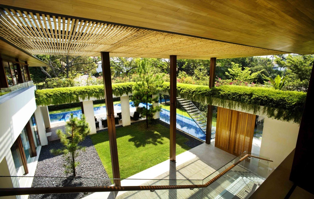 Tangga house Guz Architects with a green roof design