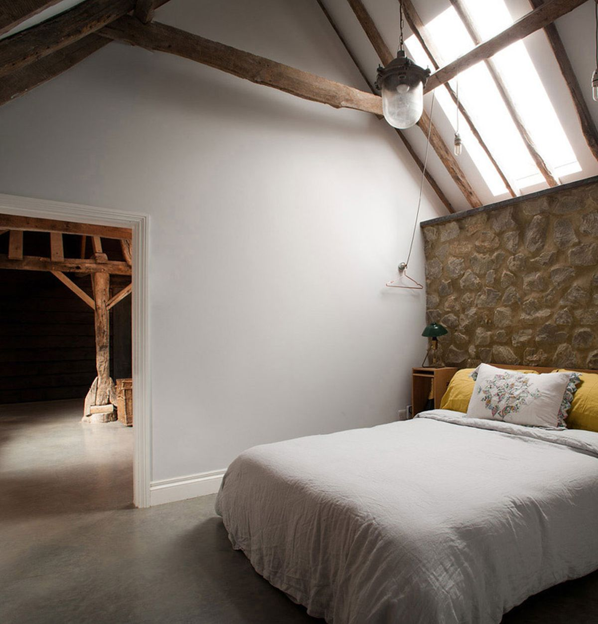 The Ancient Party Barn conversion bedroom interior