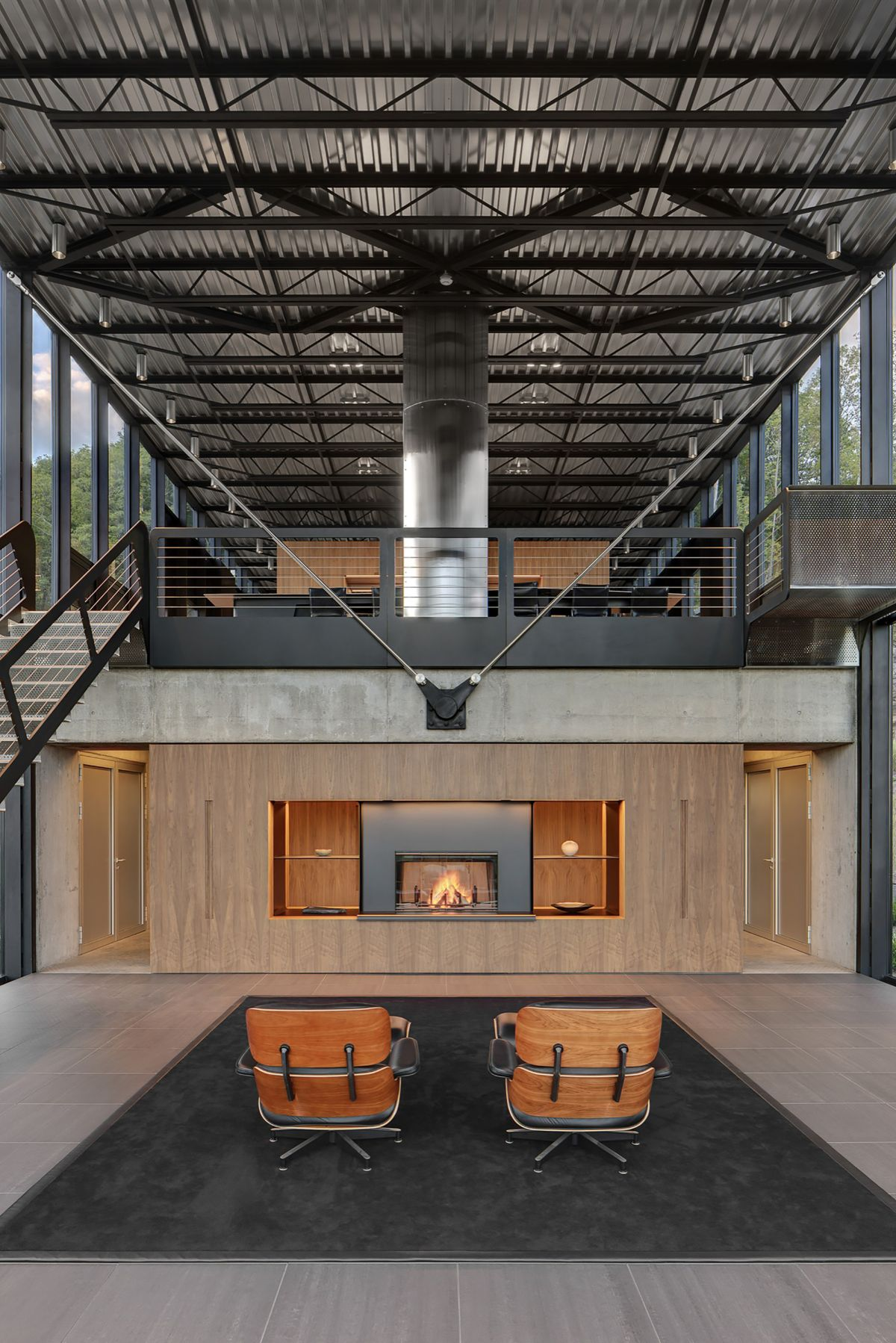 Two Eames Lounge chairs faced on fireplace